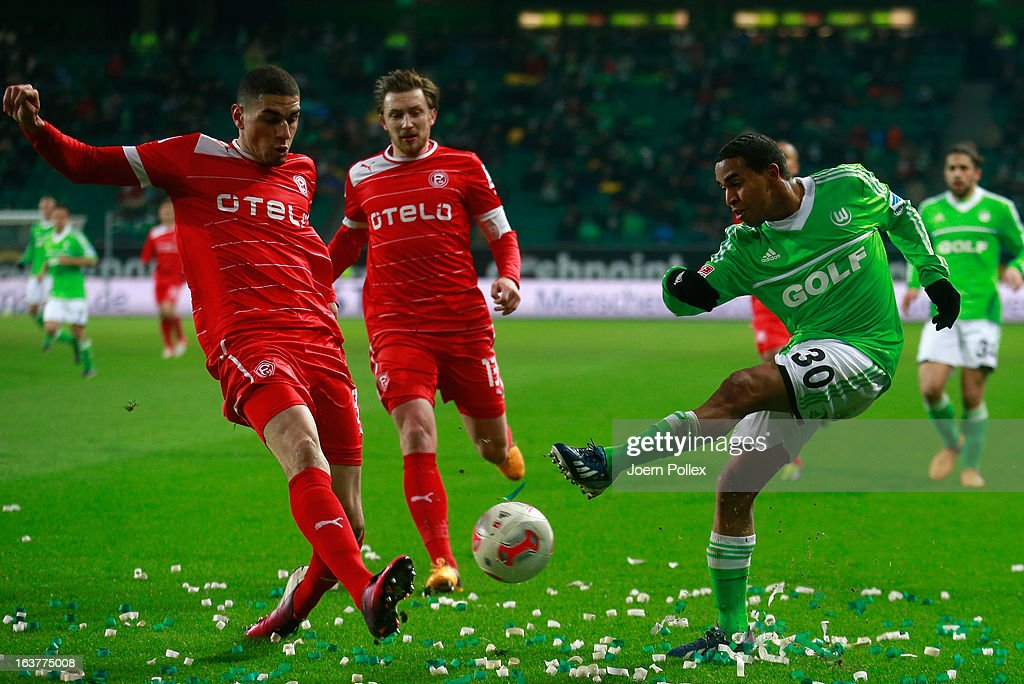 Yohandry Orozco (R) of Wolfsburg and Mathis Bolly of Duesseldorf compete for the ball during the Bundesliga match between VfL Wolfsburg and Fortuna Duesseldorf 1895 at Volkswagen Arena on March 15, 2013 in Wolfsburg, Germany.