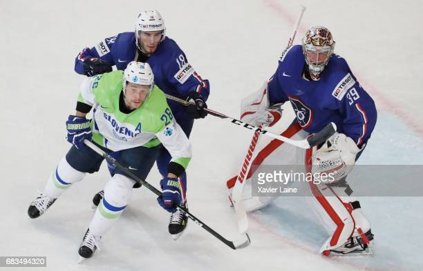 Yohann Auvitu and Cristobal Huet of France in action for his last game of his career during the 2017 IIHF Ice Hockey World Championship game between...