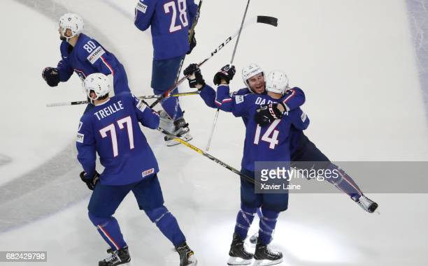 Yohann Auvitu of France celebrate the victory with teammattes during the 2017 IIHF Ice Hockey World Championship game between France and Belarus at...