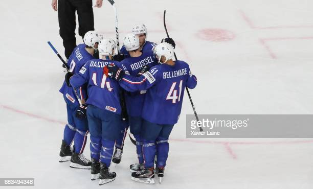 Yohann Auvitu of France celebrates his goal with PierreEdouard Bellemare and Kevin Hecquefeuilles during the 2017 IIHF Ice Hockey World Championship...