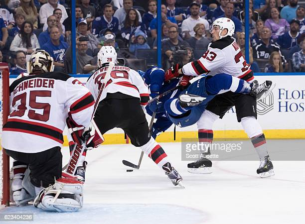 Yohann Auvitu of New Jersey Devils checks a player from the Tampa Bay Lightning at Amalie Arena on November 5 2016 in Tampa Florida 'n