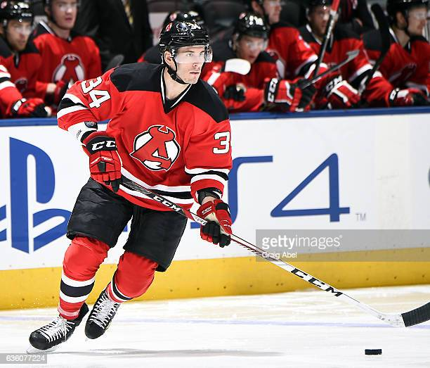 Yohann Auvitu of the Albany Devils controls the puck against the Toronto Marlies during AHL game action on December 17 2016 at Air Canada Centre in...