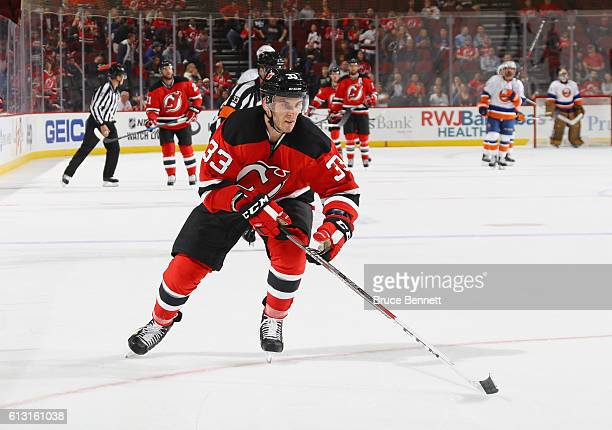 Yohann Auvitu of the New Jersey Devils skates against the New York Islanders at the Prudential Center on October 5 2016 in Newark New Jersey