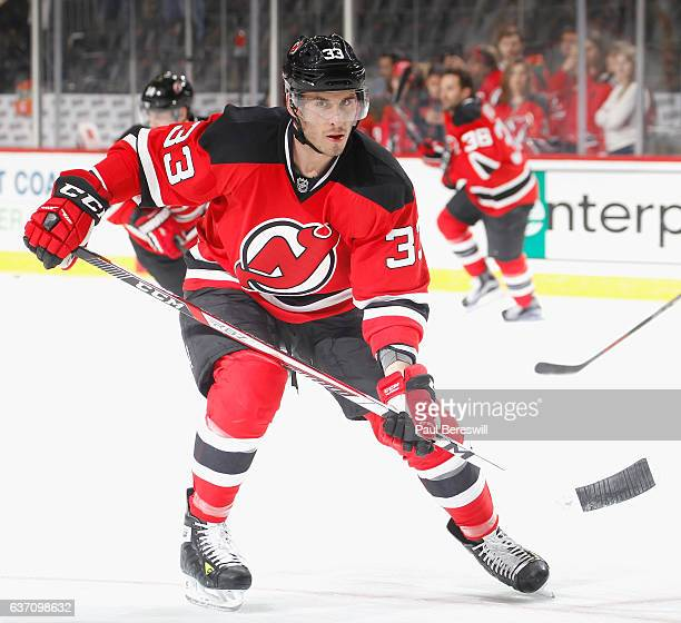 Yohann Auvitu of the New Jersey Devils skates during warmups before an NHL hockey game against the Pittsburgh Penguins at Prudential Center on...