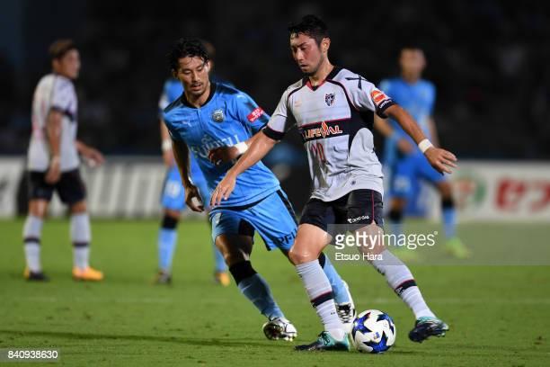 Yohei Kajiyama of FC Tokyo and Akihiro Ienaga of Kawasaki Frontale compete for the ball during the JLeague Levain Cup quarter final first leg match...