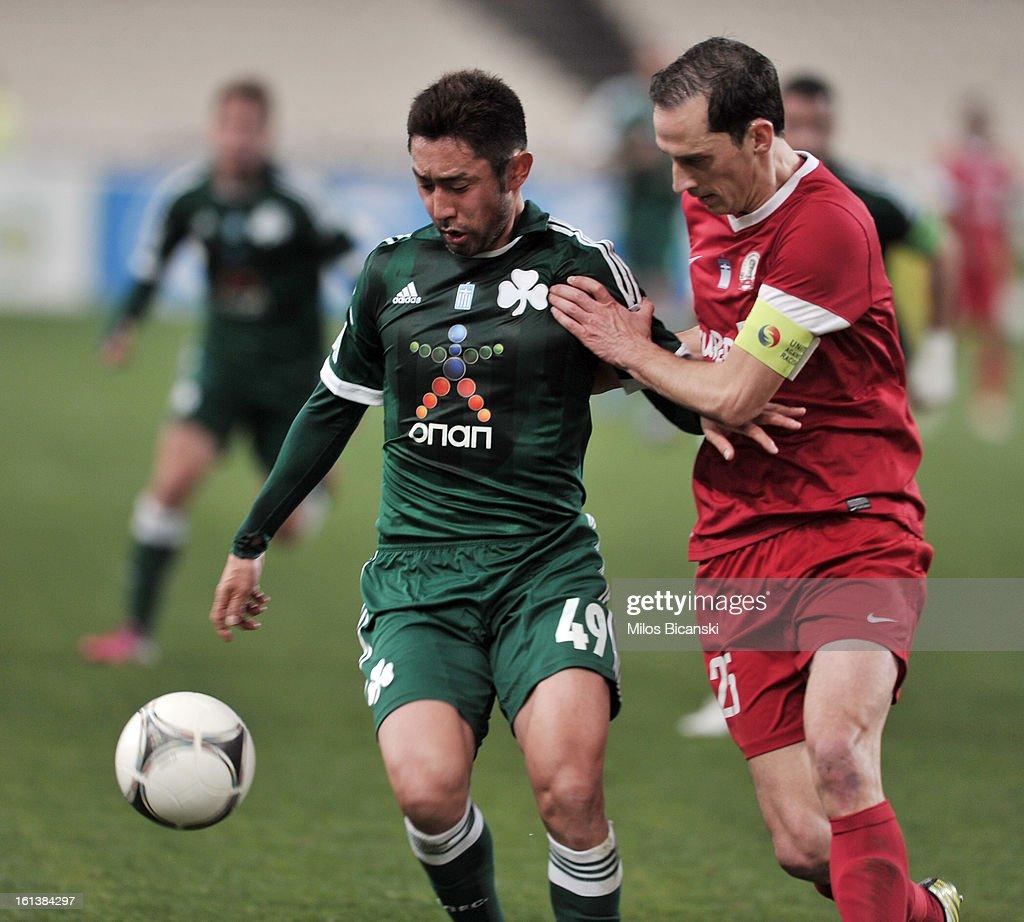 Yohei Kajiyama of Panathinaikos FC competes for the ball with Stefanos Kotsolis (R) of Skoda Xanthi during the Superleague match between Panathinaikos FC and Skoda Xanthi at OAKA Stadion on February 10, 2013 in Athens,Greece.