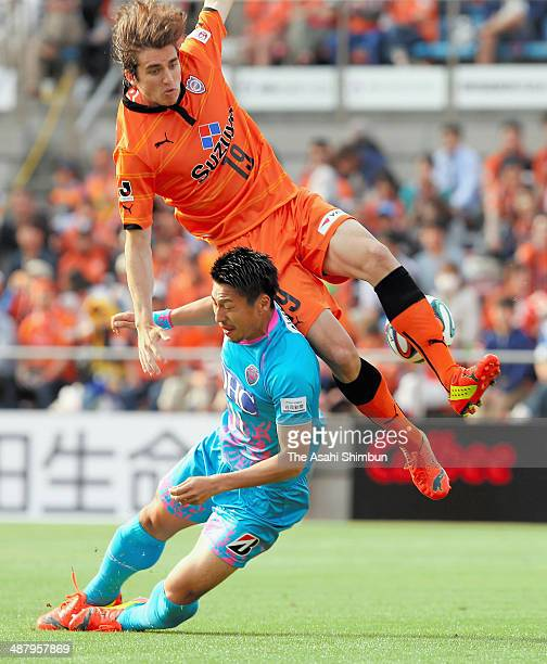 Yohei Toyoda of Sagan Tosu and Dejan Jakovic of Shimizu SPulse compete for the ball during the JLeague match between Shimizu SPulse and Sagan Tosu at...