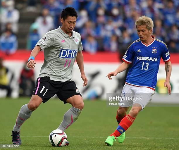 Yohei Toyoda of Sagan Tosu and Yuzo Kobayashi of Yokohama FMarinos compete for the ball during the J League match between Yokohama FMarinos and Sagan...