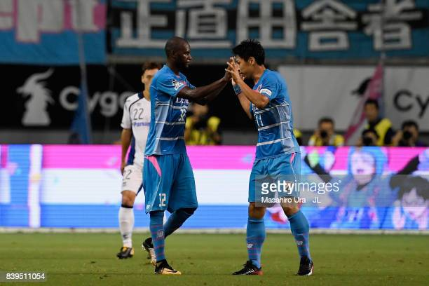 Yohei Toyoda of Sagan Tosu celebrates scoring his side's first goal with his team mate Victor Ibarbo during the JLeague J1 match between Sagan Tosu...
