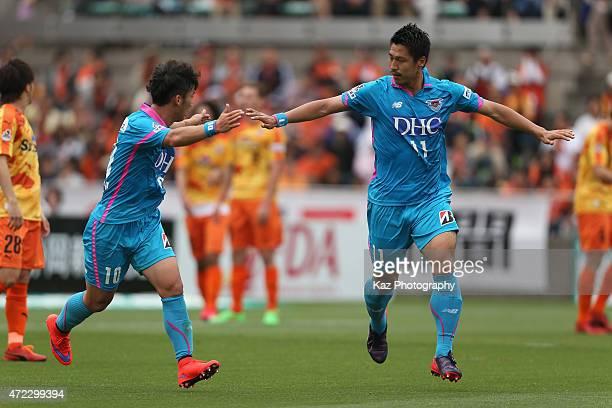 Yohei Toyoda of Sagan Tosu celebrates scoring his team's first goal with his team mate Kim MinWoo during the JLeague match between Shimizu SPulse and...