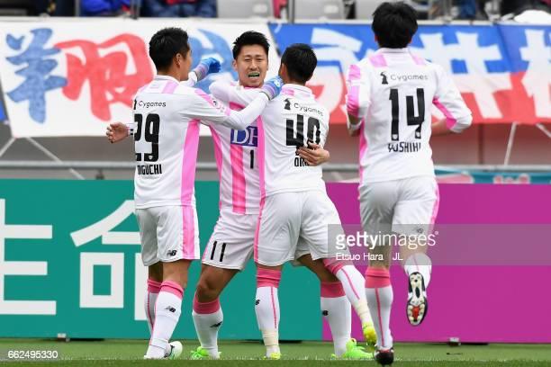 Yohei Toyoda of Sagan Tosu celebrates scoring the opening goal with his team mates during the JLeague J1 match between FC Tokyo and Sagan Tosu at...