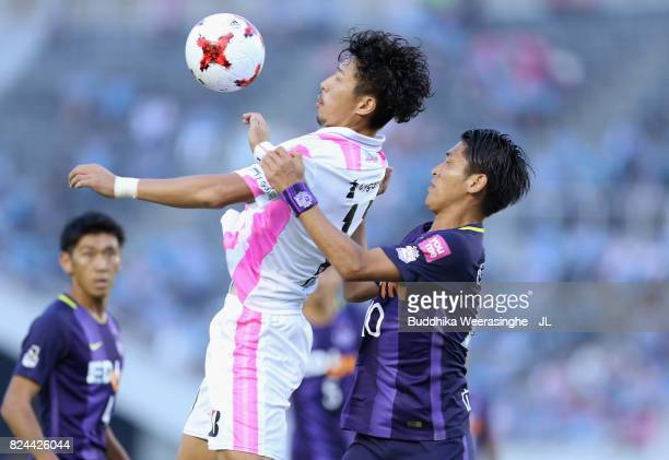 Yohei Toyoda of Sagan Tosu controls the ball under pressure of Daiki Niwa of Sanfrecce Hiroshima during the JLeague J1 match between Sanfrecce...