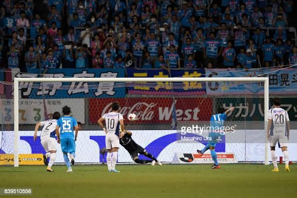 Yohei Toyoda of Sagan Tosu converts the penalty to score his side's first goal past Masaaki Higashiguchi of Gamba Osaka during the JLeague J1 match...