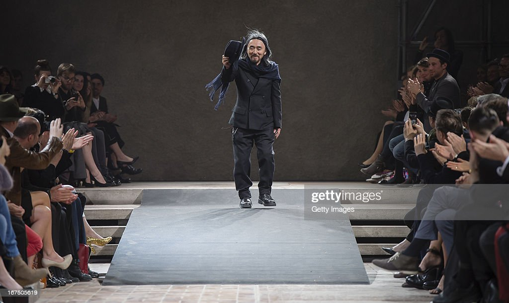Yohji Yamamoto shows up at the end of the Yohji Yamamoto fashion show 'Cutting Age' at St. Agnes Church on April 25, 2013 in Berlin, Germany.