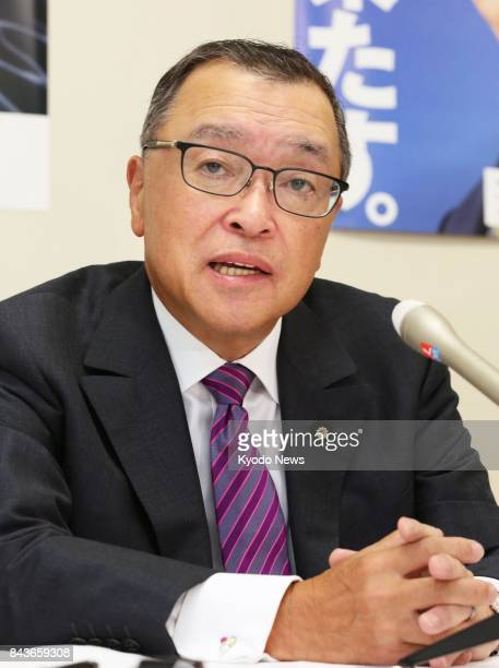 Yoichi Miyazawa head of the ruling Liberal Democratic Party's tax panel speaks to a group of reporters at the LDP's headquarters in Tokyo on Sept 7...
