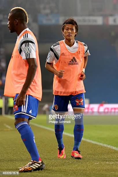 Yoichiro Kakitani and Geoffroy Serey Die warm up during the Raiffeisen Super League match between FC Basel and FC Zurich at St JakobPark on August 9...