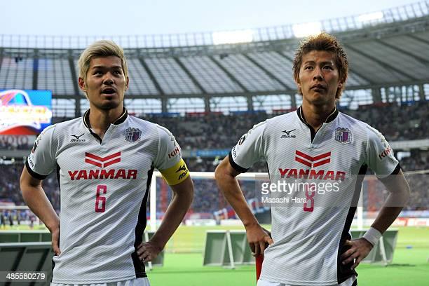 Yoichiro Kakitani and Hotaru Yamaguchi of Cerezo Osaka look on after the JLeague match between FC Tokyo and Cerezo Osaka at Ajinomoto Stadium on...