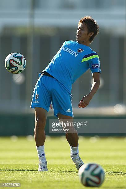 Yoichiro Kakitani bumps the ball with his hip during a Japan training session at the Japan national team base camp at the Spa Sport Resort on June 17...