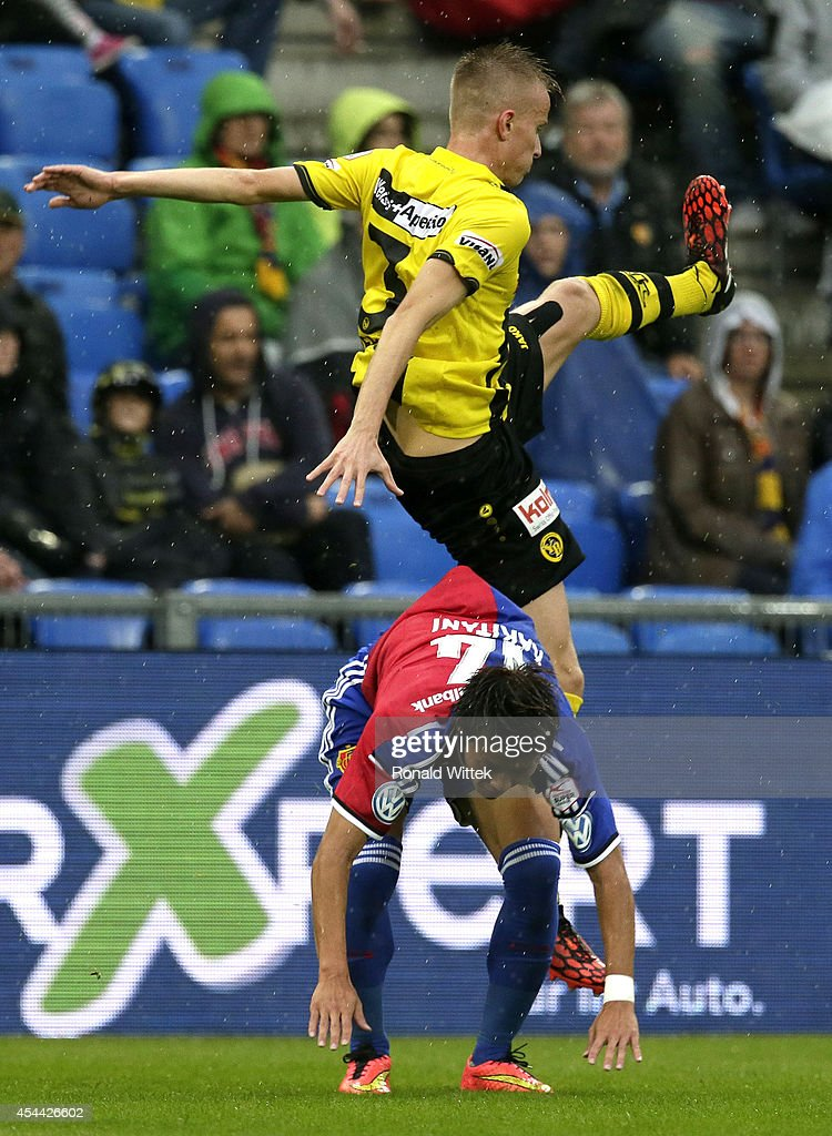 Yoichiro Kakitani of Basel and Steve Hadergjonaj of Bern compete for the ball during the Raiffeisen Super League match between FC Basel and BSC Young Boys Bern at St.Jakob-Park on August 31, 2014 in Basel, Switzerland.