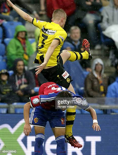 Yoichiro Kakitani of Basel and Steve Hadergjonaj of Bern compete for the ball during the Raiffeisen Super League match between FC Basel and BSC Young...