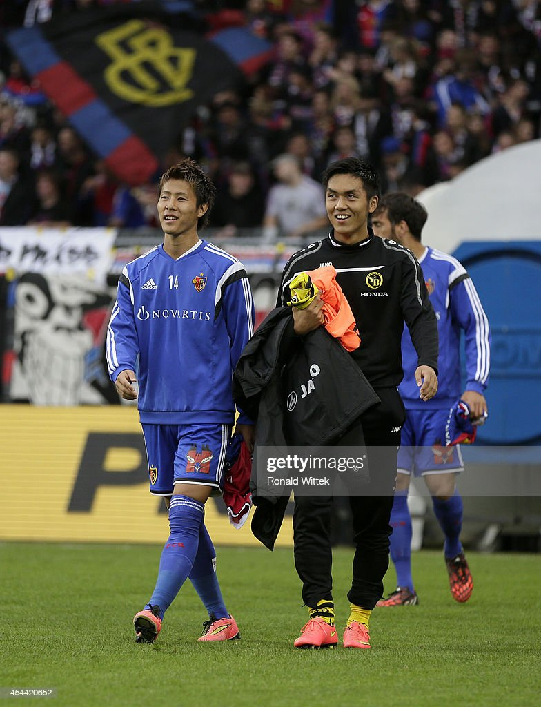 Yoichiro Kakitani (L) of Basel and Yuya Kubo of Bern entering the stadion during the Raiffeisen Super League match between FC Basel and BSC Young Boys Bern at St.Jakob-Park on August 31, 2014 in Basel, Switzerland.
