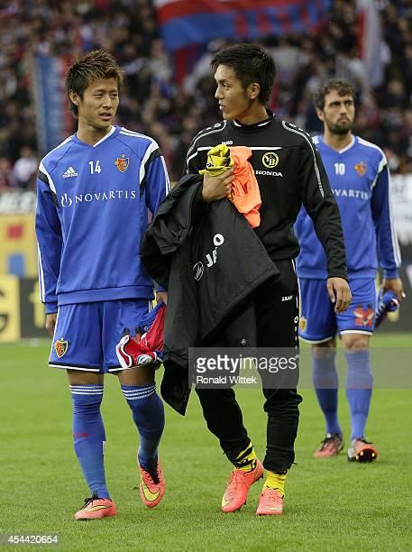 Yoichiro Kakitani of Basel and Yuya Kubo of Bern entering the stadion during the Raiffeisen Super League match between FC Basel and BSC Young Boys...