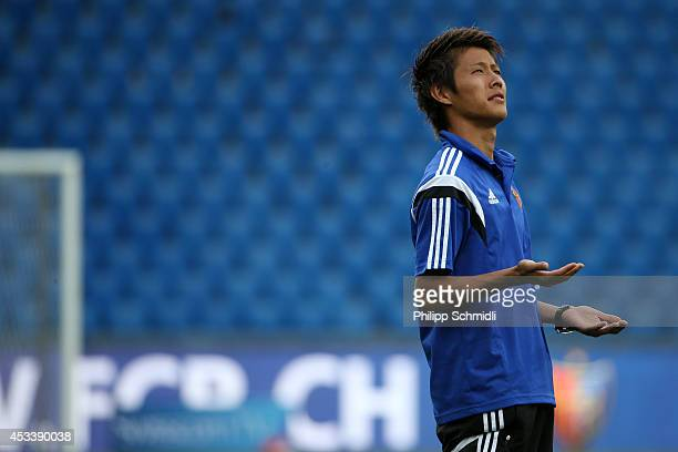 Yoichiro Kakitani of Basel checks the weather prior to the Raiffeisen Super League match between FC Basel and FC Zurich at St JakobPark on August 9...