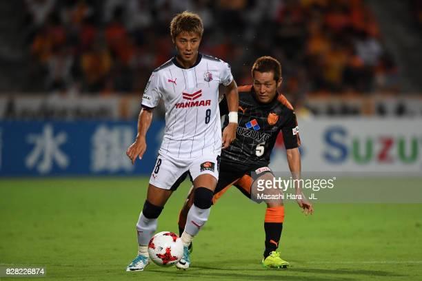 Yoichiro Kakitani of Cerezo Osaka controls the ball under pressure of Shoma Kamata of Shimizu SPulse during the JLeague J1 match between Shimizu...