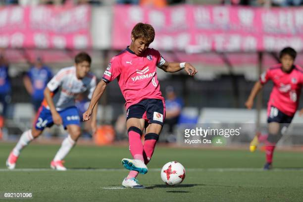 Yoichiro Kakitani of Cerezo Osaka converts the penalty to score the opening goal during the JLeague J1 match between Cerezo Osaka and Albirex Niigata...