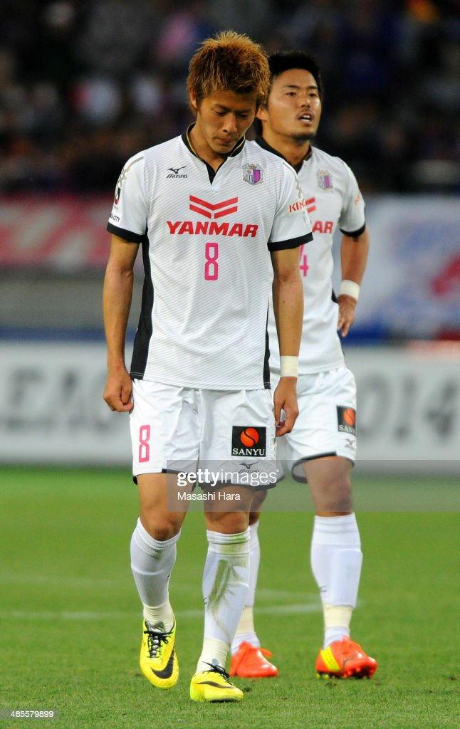 <a gi-track='captionPersonalityLinkClicked' href=/galleries/search?phrase=Yoichiro+Kakitani&family=editorial&specificpeople=7883667 ng-click='$event.stopPropagation()'>Yoichiro Kakitani</a> #8 of Cerezo Osaka react after the J.League match between F.C. Tokyo and Cerezo Osaka at Ajinomoto Stadium on April 19, 2014 in Tokyo, Japan.