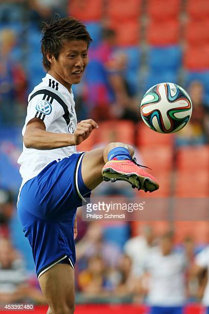 Yoichiro Kakitani of FC Basel juggles the ball prior to the Raiffeisen Super League match between FC Basel and FC Zurich at St JakobPark on August 9...