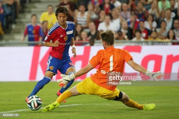 Yoichiro Kakitani of FC Basel scores a goal against goalkeeper David Da Costa of FC Zurich during the Raiffeisen Super League match between FC Basel...