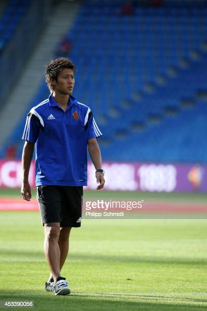 Yoichiro Kakitani of FC Basel walks on pitch prior to the Raiffeisen Super League match between FC Basel and FC Zurich at St JakobPark on August 9...