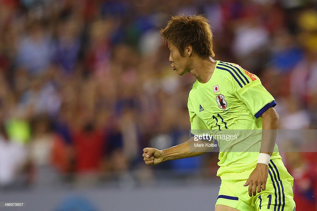 <a gi-track='captionPersonalityLinkClicked' href=/galleries/search?phrase=Yoichiro+Kakitani&family=editorial&specificpeople=7883667 ng-click='$event.stopPropagation()'>Yoichiro Kakitani</a> of Japan celebrates scoring a goal during the International Friendly Match between Japan and Costa Rica at Raymond James Stadium on June 2, 2014 in Tampa, Florida.