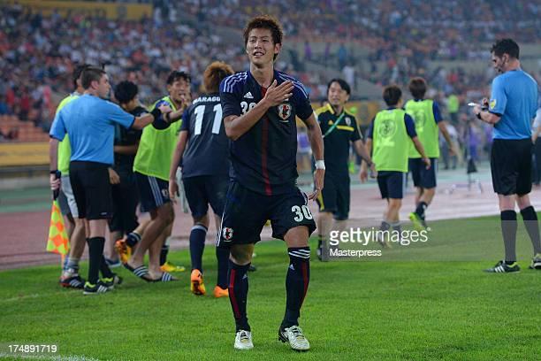 Yoichiro Kakitani of Japan celebrates scoring his team's second goal during the EAFF East Asian Cup match between Korea Republic and Japan at Jamsil...