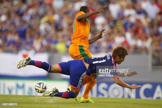 Yoichiro Kakitani of Japan is fouled by Stoppila Sunzu of Zambia during the International Friendly Match between Japan and Zambia at Raymond James...