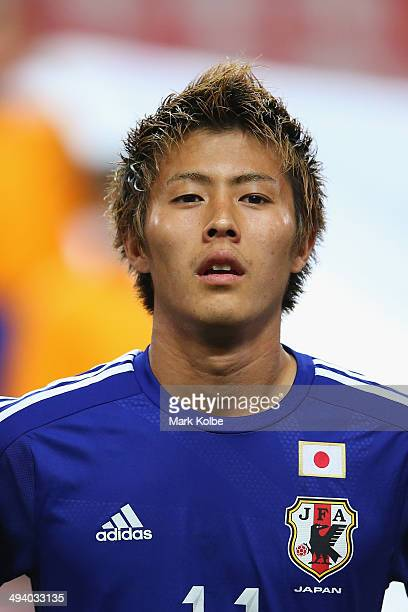 Yoichiro Kakitani of Japan looks on during the anthems ahead of the Kirin Challenge Cup international friendly match between Japan and Cyprus at...