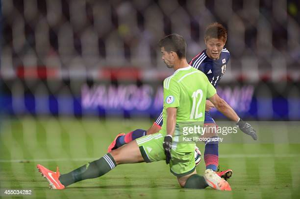 Yoichiro Kakitani of Japan misses the chance to score under the pressure from Daniel Hernandez of venezuela during the KIRIN CHALLENGE CUP 2014...