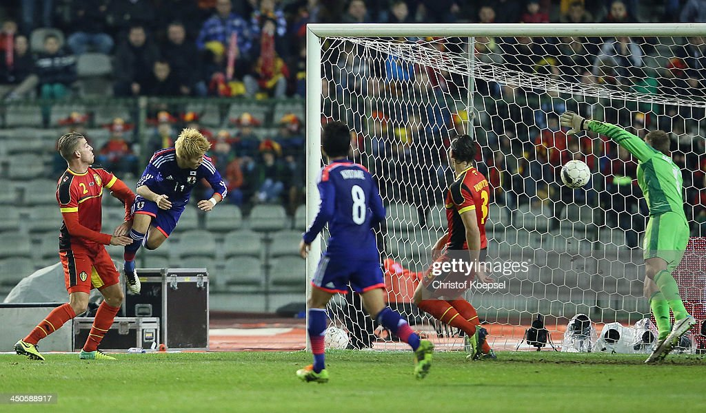 Yoichiro Kakitani of Japan (2nd L) scores the first goal againts <a gi-track='captionPersonalityLinkClicked' href=/galleries/search?phrase=Toby+Alderweireld&family=editorial&specificpeople=653048 ng-click='$event.stopPropagation()'>Toby Alderweireld</a> of Belgium (L), <a gi-track='captionPersonalityLinkClicked' href=/galleries/search?phrase=Daniel+van+Buyten&family=editorial&specificpeople=213252 ng-click='$event.stopPropagation()'>Daniel van Buyten</a> (2nd R) and <a gi-track='captionPersonalityLinkClicked' href=/galleries/search?phrase=Simon+Mignolet&family=editorial&specificpeople=7124442 ng-click='$event.stopPropagation()'>Simon Mignolet</a> of Belgium (R) during the international friendly match between Belgium and Japan at King Badouin stadium on November 19, 2013 in Brussels, Belgium.