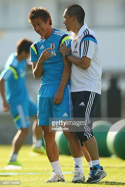 Yoichiro Kakitani shares a joke with a member of the training staff during a Japan training session at the Japan national team base camp at the Spa...