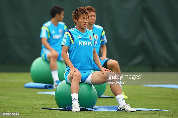 Yoichiro Kakitani stretches as he sits on a ball during a Japan training session at North Greenwood Recreation Aquatic Complex on June 3 2014 in...