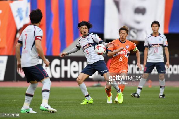 Yojiro Takahagi of FC Tokyo and Kei Koizumi of Albirex Niigata compete for the ball during the JLeague J1 match between Albirex Niigata and FC Tokyo...