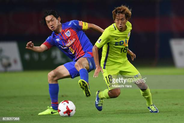 Yojiro Takahagi of FC Tokyo and Yoshifumi Kashiwa of Sanfrecce Hiroshima compete for the ball during the JLeague Levain Cup PlayOff Stage first leg...