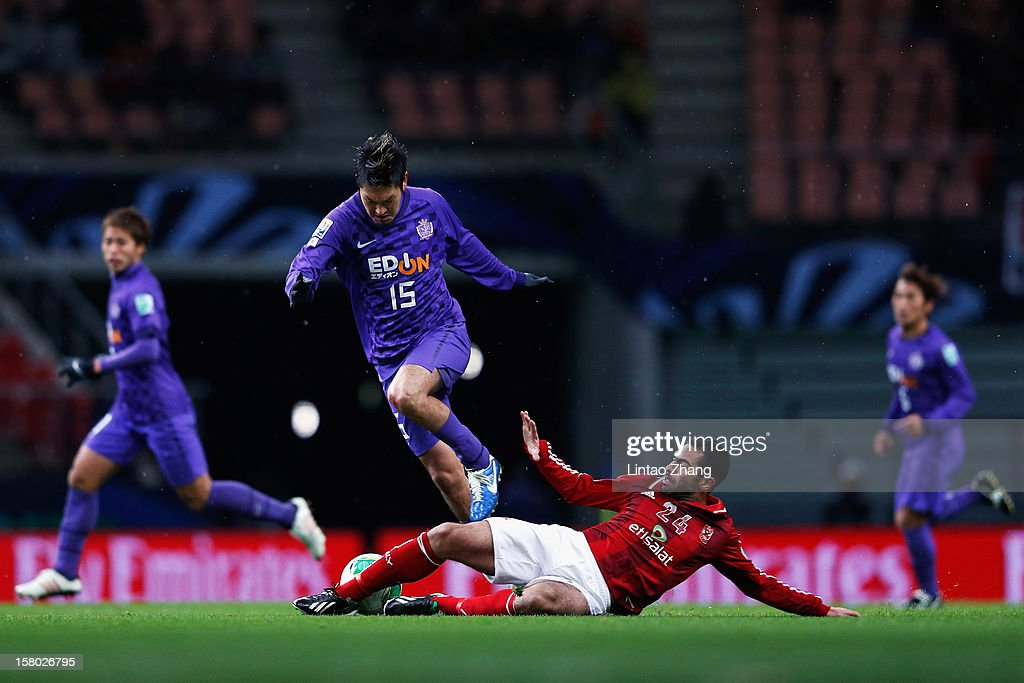 Yojiro Takahagi of Sanfrecce Hiroshima fights for the ball withAhmed Fathi of Al-Ahly during the FIFA Club World Cup Quarter Final match between Sanfrecce Hiroshima and Al-Ahly SC at Toyota Stadium on December 9, 2012 in Toyota, Japan.
