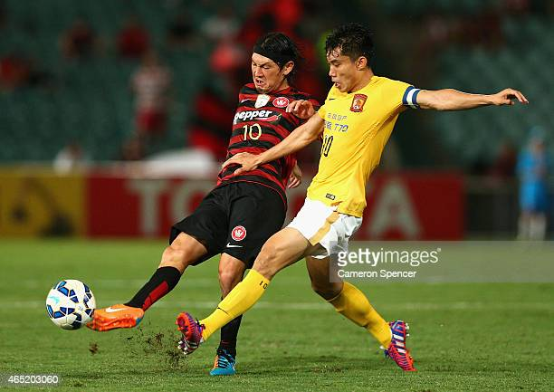 Yojiro Takahagi of the Wanderers and Zheng Zhi of Guanzhou contest the ball during the Asian Champions League match between the Western Sydney...