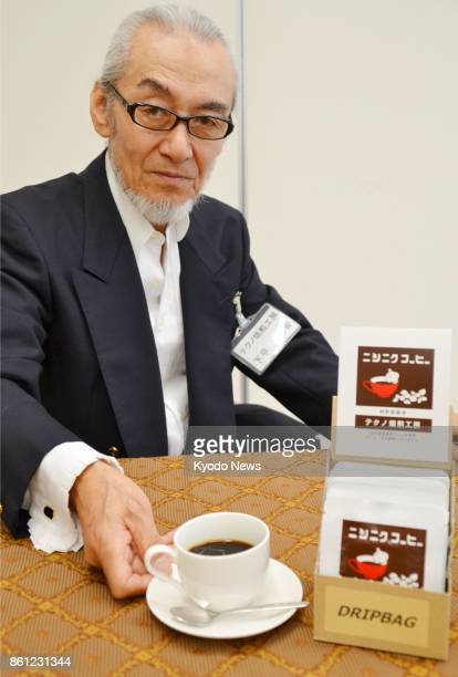 Yokitomo Shimotai is pictured with 'garlic coffee' he invented in Ninohe Iwate Prefecture on Sept 25 2017 The drink looks and tastes like coffee but...