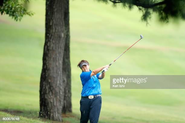 Yoko Inoue of Japan hits a second shot on the 18th hole during the final round of the Yupiteru The Shizuoka Shimbun SBS Ladies at the Shizuoka...