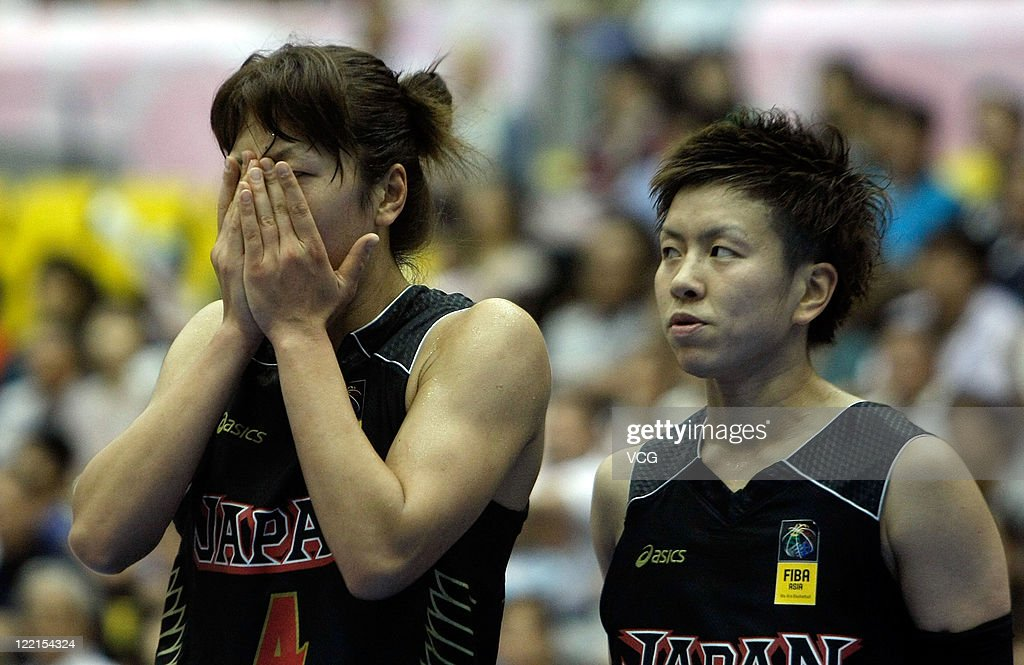 Yoko Nagi and Yuko Oga of Japan in action in the group match during the 2011 FIBA Asia Championship For Women at Sea Hat on August 25 2011 in...