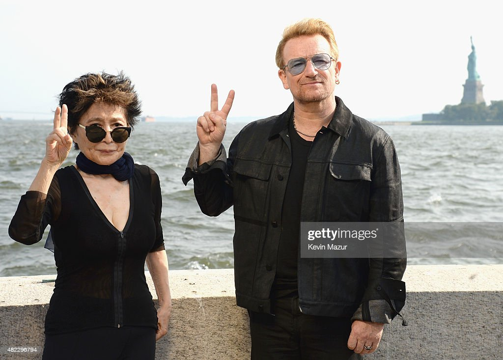 Yoko Ono and Bono attend Amnesty International Tapestry Honoring John Lennon Unveiling at Ellis Island on July 29 2015 in New York City