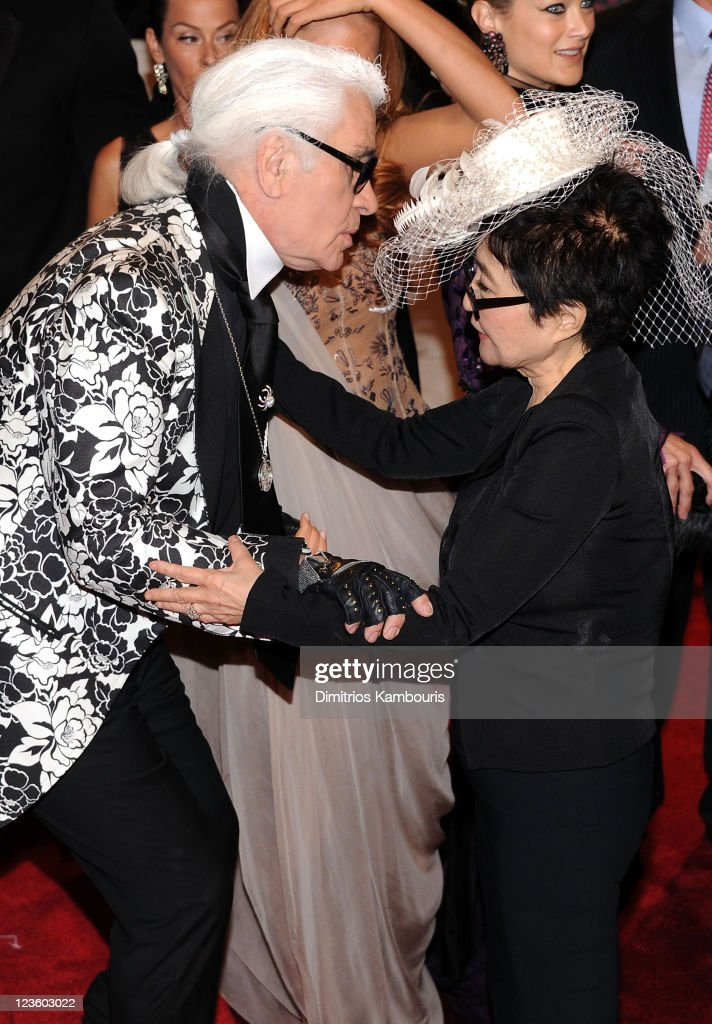 Yoko Ono (R) and designer Karl Lagerfeld attend the 'Alexander McQueen: Savage Beauty' Costume Institute Gala at The Metropolitan Museum of Art on May 2, 2011 in New York City.
